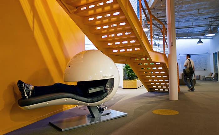 An employee using a sleeping pod at Google's offices in California