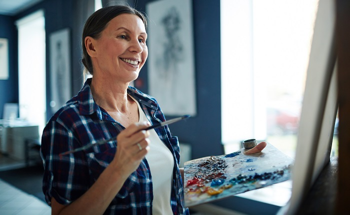 Woman painting a picture in art studio